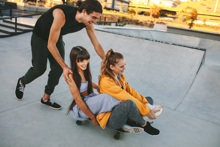 Group of friends enjoying at skate park