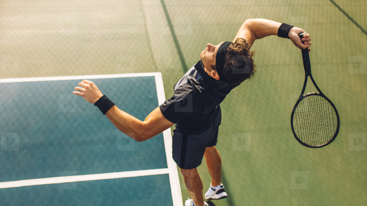 Tennis player serving in the match