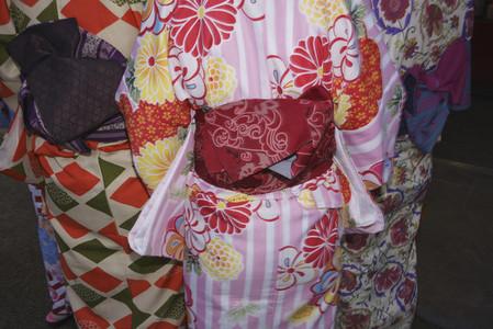 Geishas wearing multicolor kimonos 01
