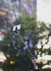 Tourist with selfie stick 01
