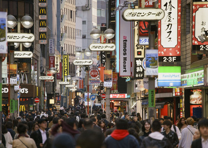 Pedestrians on bustling modern city street 01