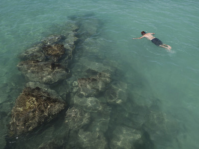 Man snorkeling in turquoise ocean 01