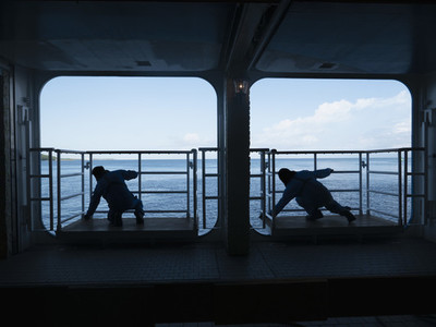 Silhouette male workers on cruise ship platforms 01
