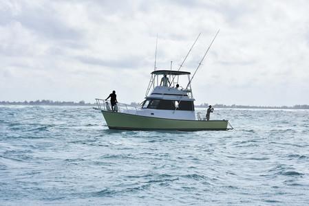 Fishing boat on choppy ocean 01