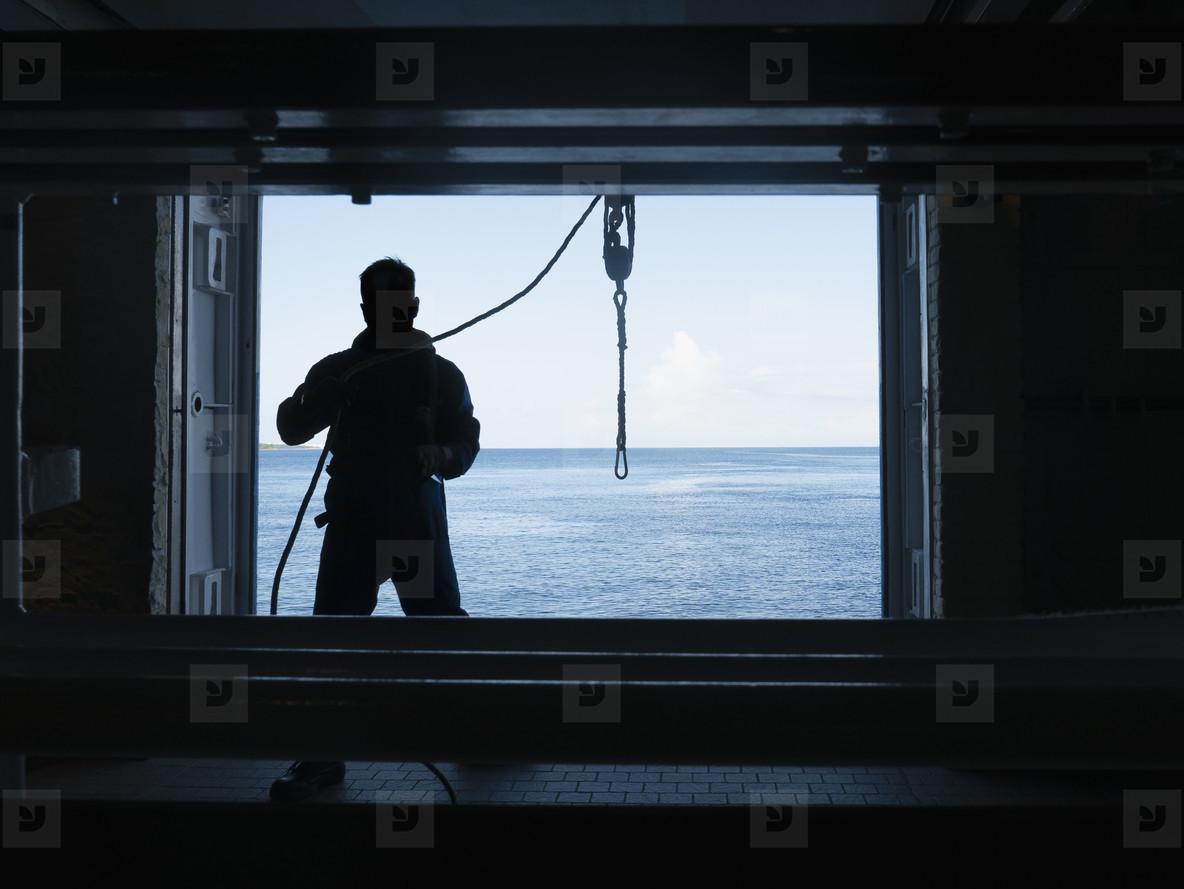 Man working at opening of cruise ship  01