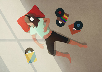 Carefree girl with headphones listening to records 01