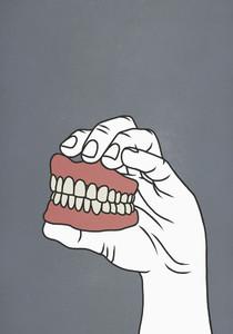 Hand holding dentures 01