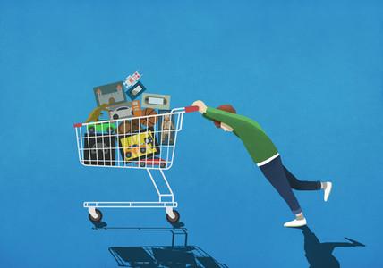 Boy pushing shopping cart full of toys 01