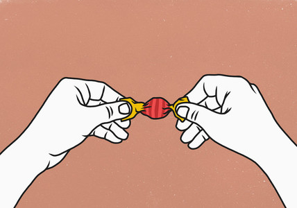 Hands opening wrapped candy 01