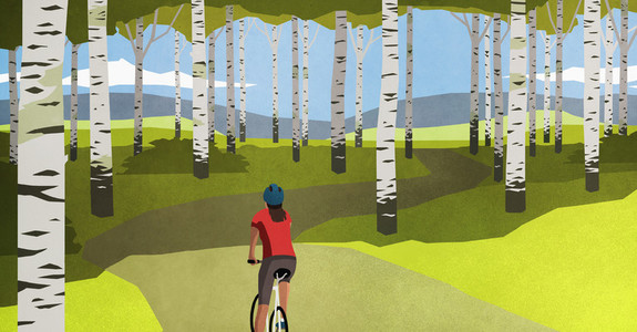 Woman mountain biking on path through trees in idyllic forest 01