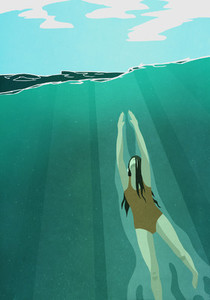Woman swimming  ascending to ocean surface 01
