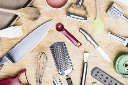 View from above kitchen utensils on wooden surface   knolling 01