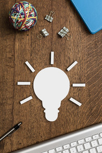 View from above light bulb on wooden desk 01