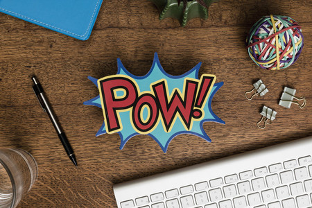 View from above POW sign on wooden desk 01