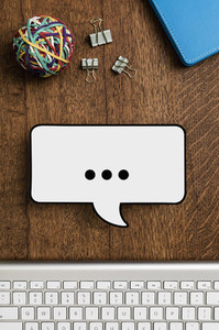 View from above paper speech bubble on wooden desk 01
