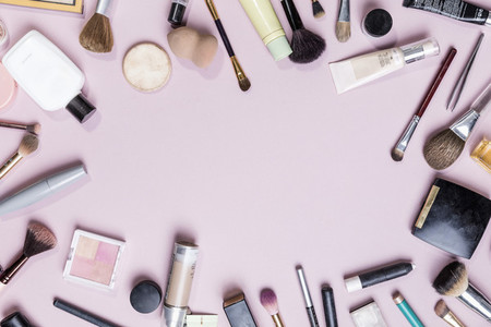 View from above makeup and beauty products on pink background   knolling 01