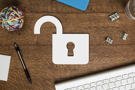 View from above paper padlock on wooden desk 01