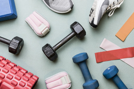 View from above dumbbells and exercise equipment   knolling 01