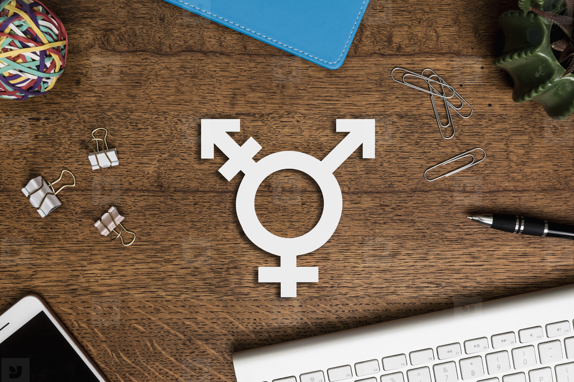 View from above transgender symbol on wooden desk  01