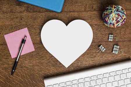 Paper heart shape on wooden desk 01