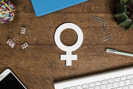View from above paper female symbol on wooden desk 01