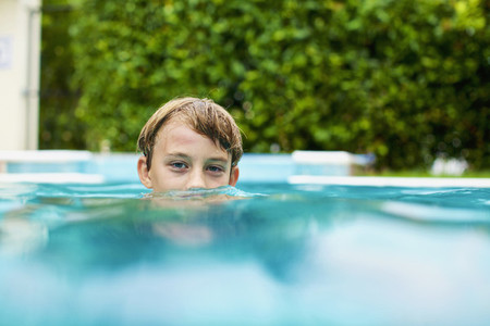 Portrait boy swimming in swimming pool 01