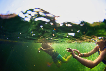 Underwater view of kids swimming in lake 01