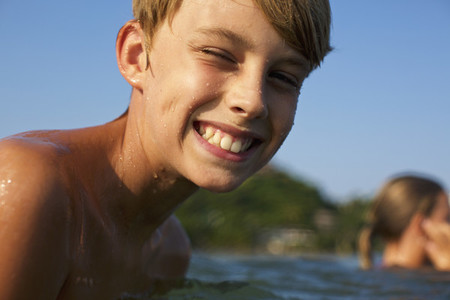 Portrait happy carefree boy swimming in lake 01