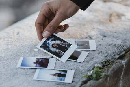 Woman looking at instant photos 01