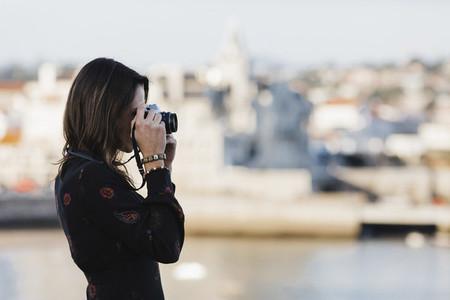 Female tourist using camera Cascais Lisbon 01