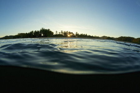 Tranquil silky ocean surface at sunrise 01