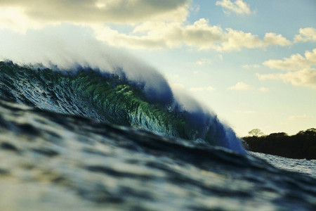 Breaking ocean wave at sunset 01
