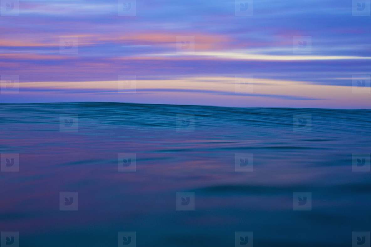 Tranquil blue and pink ocean and sky at sunrise  01