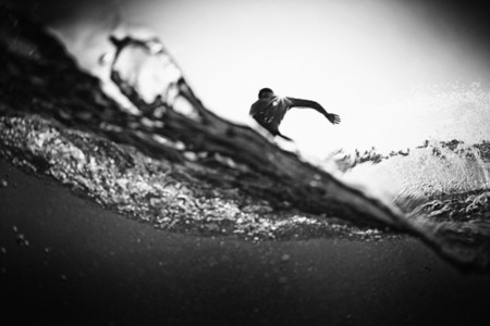 Male surfer making cutback from behind ocean wave 01
