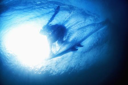 Underwater view sunshine over surfer 01