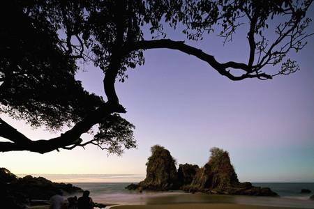 Man on idyllic tranquil beach at sunset 01