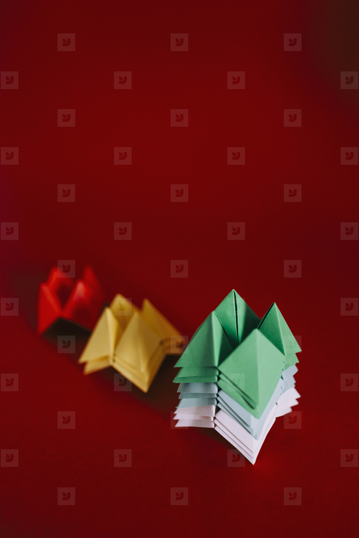Multicolored origami fortune tellers on red background  01