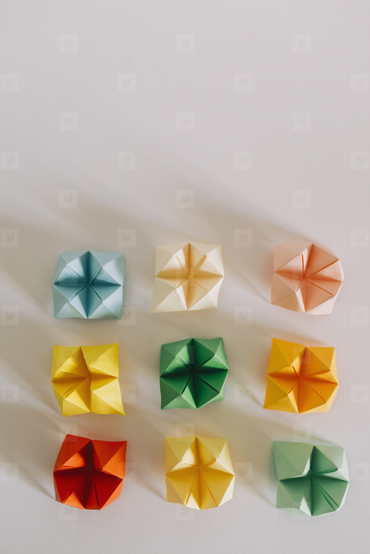 Multicolored origami fortune tellers on white background  01