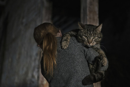 Girl holding cat over shoulder 01