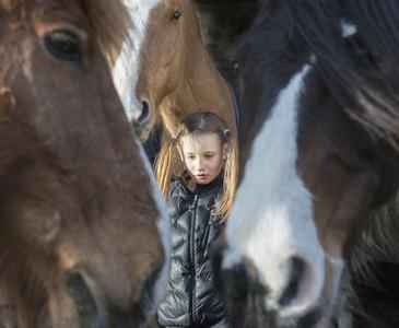 Serene girl with horses 01