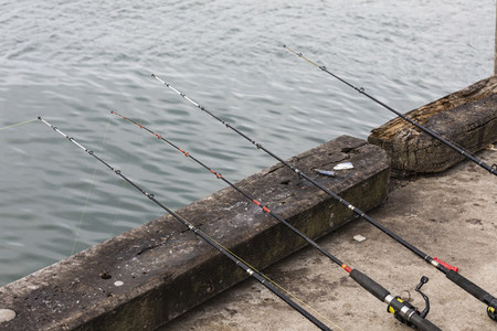 Fishing rods hanging over pier 01