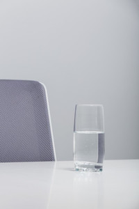 Glass of water on conference room table 01