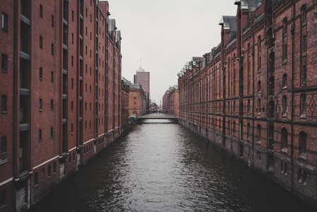 Hafencity canal between brick warehouse buildings 01