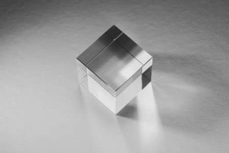 Clear   artificial resin cube reflecting light 01