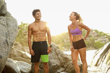 Young fit couple laughing on beach 01
