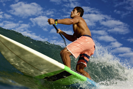 Fit young man paddleboarding ocean wave 01