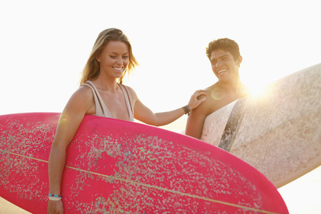 Happy young couple with surfboards 01