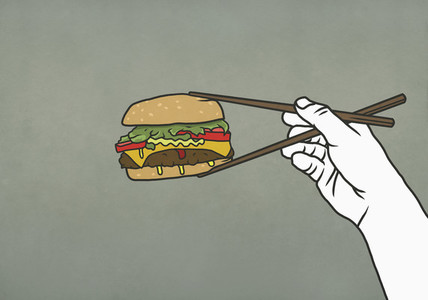 Man eating cheeseburger with chopsticks 01