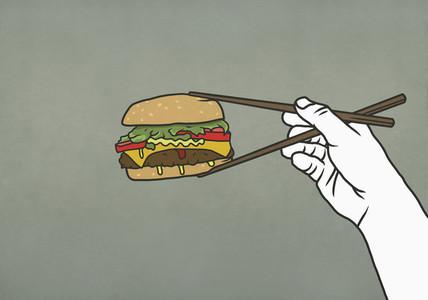 Man eating cheeseburger with chopsticks 01