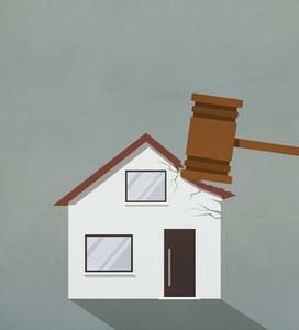 Foreclosure gavel pounding on house 01